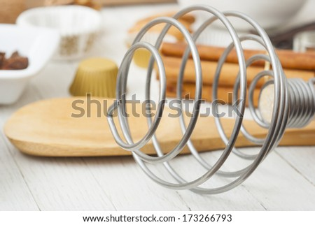 dessert ingredients and equipments on white wooden table