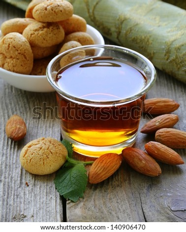 Dessert liqueur Amaretto with almond biscuits (amaretti) and nuts - stock photo
