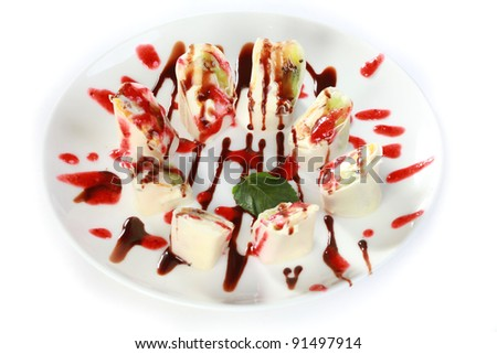 Dessert Maki Sushi - Sweet Roll with Various Fruit and Cream Cheese inside. Pancake outside. Served in Strawberries Sauce