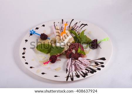 Dessert of ice cream with waffles, berries, sorbet decorated mint  - stock photo