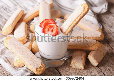 Dessert of Savoiardi with yogurt and strawberries. horizontal