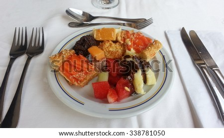 Dessert plate with assorted cookies, tarts and fruits at an all-inclusive resort buffet - stock photo