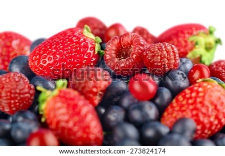 Dessert. Ripe of  berries on wooden table in garden  - blackberry, raspberry , red currant and blueberry - stock photo