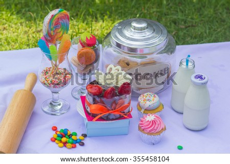 Dessert Sweet candy cookie chocolate and cupcake. - stock photo