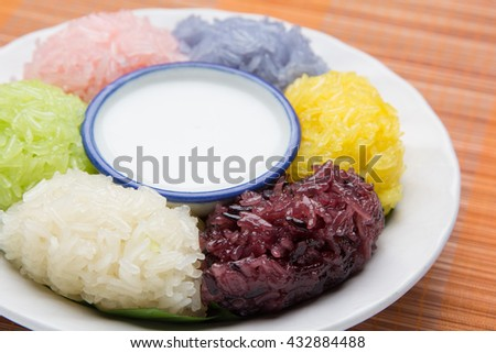 dessert sweet sticky rice with coconut milk in plate on wood pattern background