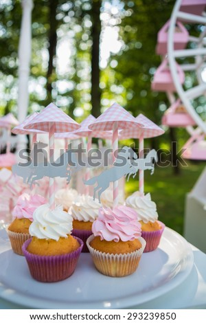 Dessert table for a party. Cake, cupcakes, sweetness and flowers. Shallow dof - stock photo