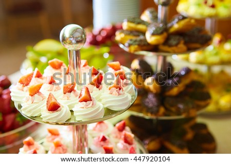 Dessert table for party. akes and sweetness. Shallow dof - stock photo