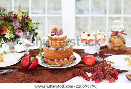 Dessert table servi?ed for a wedding. Cake, cupcakes, sweetness and flowers