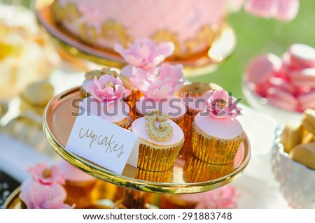 Dessert table with cakes decorated for a outdoor party - stock photo