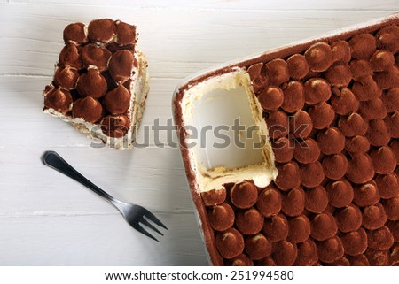 Dessert tiramisu cake on wooden background - stock photo