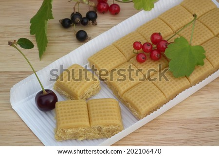 Dessert. Toffee candy with berries. - stock photo