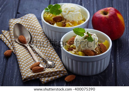 Dessert with apple and ice cream. Selective focus