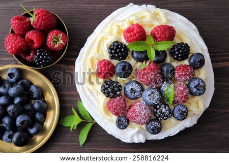 Dessert with berries, whipped cream and meringue.