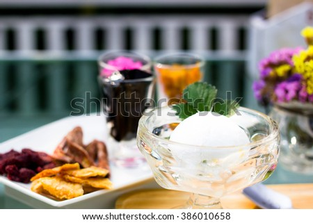 Dessert with coconut ice cream homemade topping organic dried fruits - stock photo