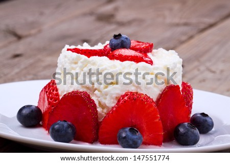 Dessert with cottage and strawberry on a plate