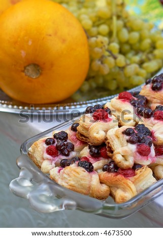 dessert with pastries and fruits - stock photo