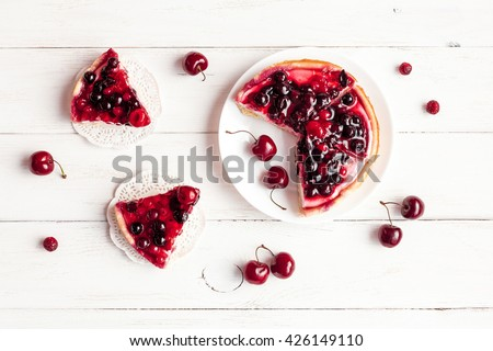 Dessert with red berries. Summer dessert on wooden white background. Top view, flat lay - stock photo