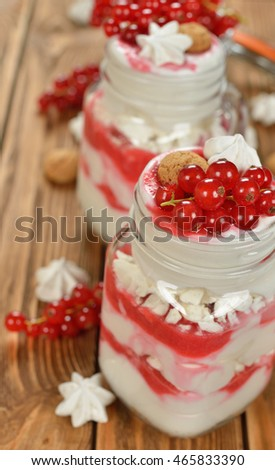 Dessert with red currant and whipped cream on a vintage background