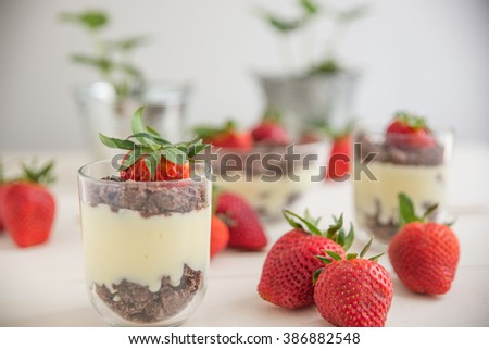 Dessert with strawberries, vanilla pudding and chocolate crumbles
