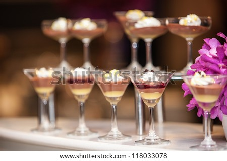 Desserts for business meeting conference participants set up in luxurious glasses - stock photo