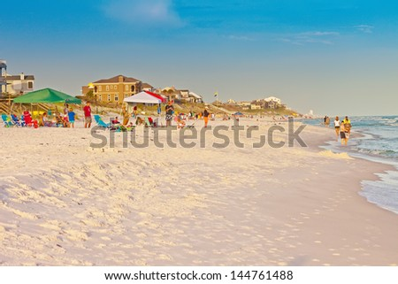 DESTIN, FL - JUNE 25:  Vacationers enjoying the sun and surf on South Walton Beach on June 25, 2013. Destin has emerald water and soft shores and has been named one of the finest beaches in the world. - stock photo