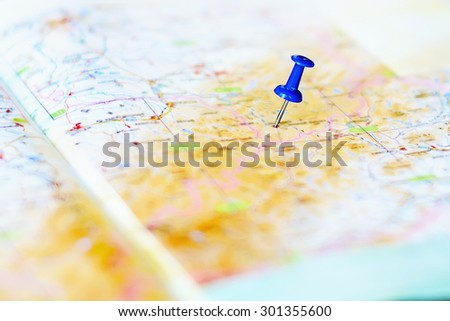 destination and blue pin on the map - stock photo