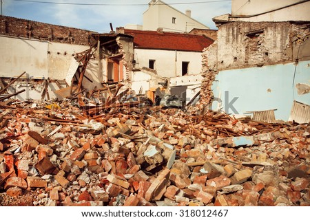 Destroyed brick buildings in the area of exposed reconstruction