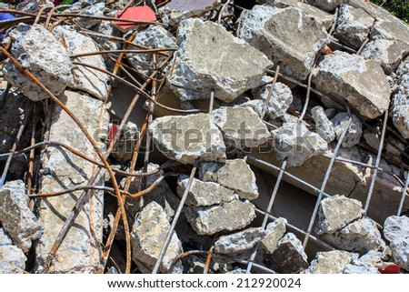 Destroyed building and pile of debris brick and cement - stock photo