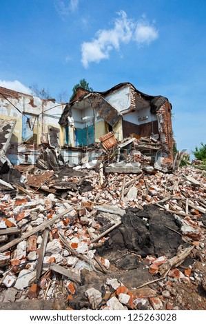 Destroyed building, can be used as demolition, earthquake, bomb, terrorist attack or natural disaster - stock photo