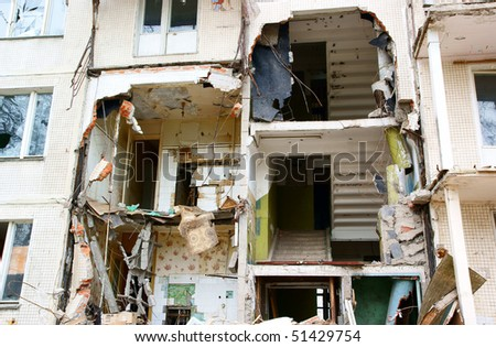 Destroyed building close up, can be used as demolition, earthquake, bomb, terrorist attack or natural disaster concept - stock photo