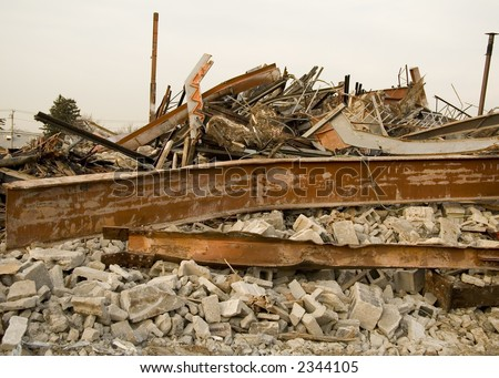 Destroyed Building Rubble with Bent Beams and Cylinder Blocks - stock photo