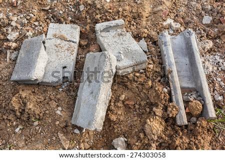 destroyed concrete bricks on rough sand - stock photo