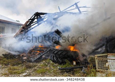 destroyed farm house by fire in Germany - stock photo