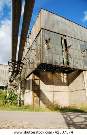 Destroyed industrial building and courtyard on crisis time