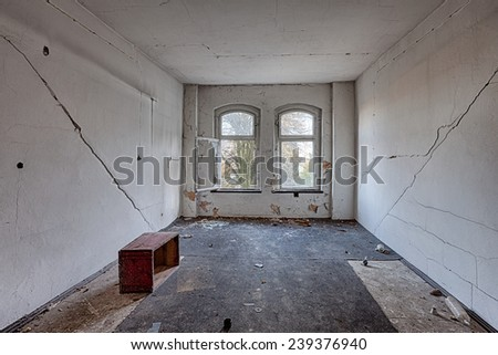 Destroyed room inside the old building - stock photo