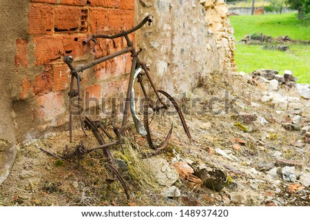 Destroyed rusty bicycle in Oradour sur Glane in the French Limousin - stock photo