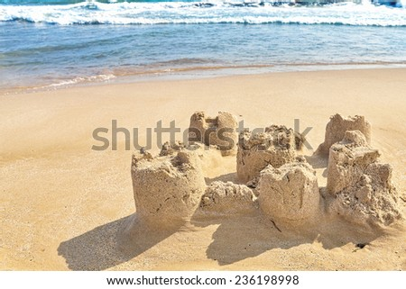 Destroyed sand castle on a beach. Spain - stock photo