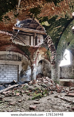 Destroyed stables with brick vault with an pillars - stock photo