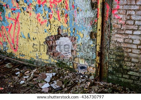 Destroyed wall in an abandoned factory building
