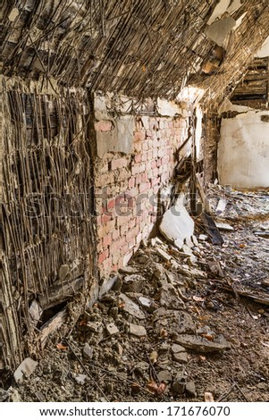 Destroyed wall of bricks in the former headquarters of Masonry in Gdansk, Poland - stock photo