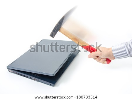 Destroying an old laptop suggesting data hack, old technology, slow computer, data protection and pc repairman - stock photo