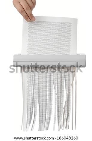 Destroying files in the document shredder - stock photo