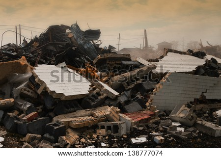 Destruction concept: bricks and debris from demolished building - stock photo