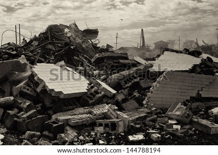 Destruction concept: bricks and debris from demolished building, B & W - stock photo