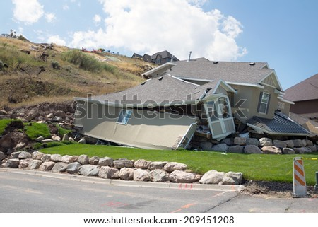 Destruction of a new home in a landslide after heavy rains - stock photo