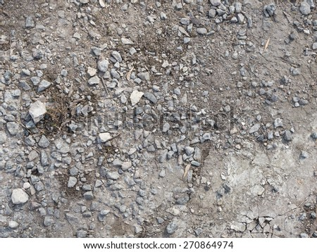 destruction of the old asphalt and visible dirt and gravel - stock photo