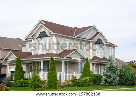 Detached family home in suburban development - stock photo