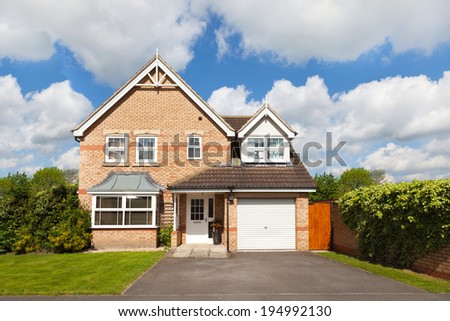 Detached house with a garage - stock photo