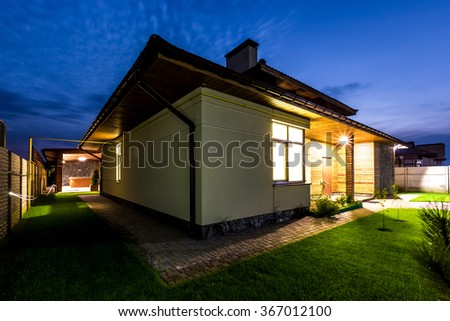 Detached Luxury House At Night View From Outside