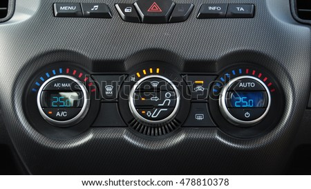 detail air conditioning button inside a car